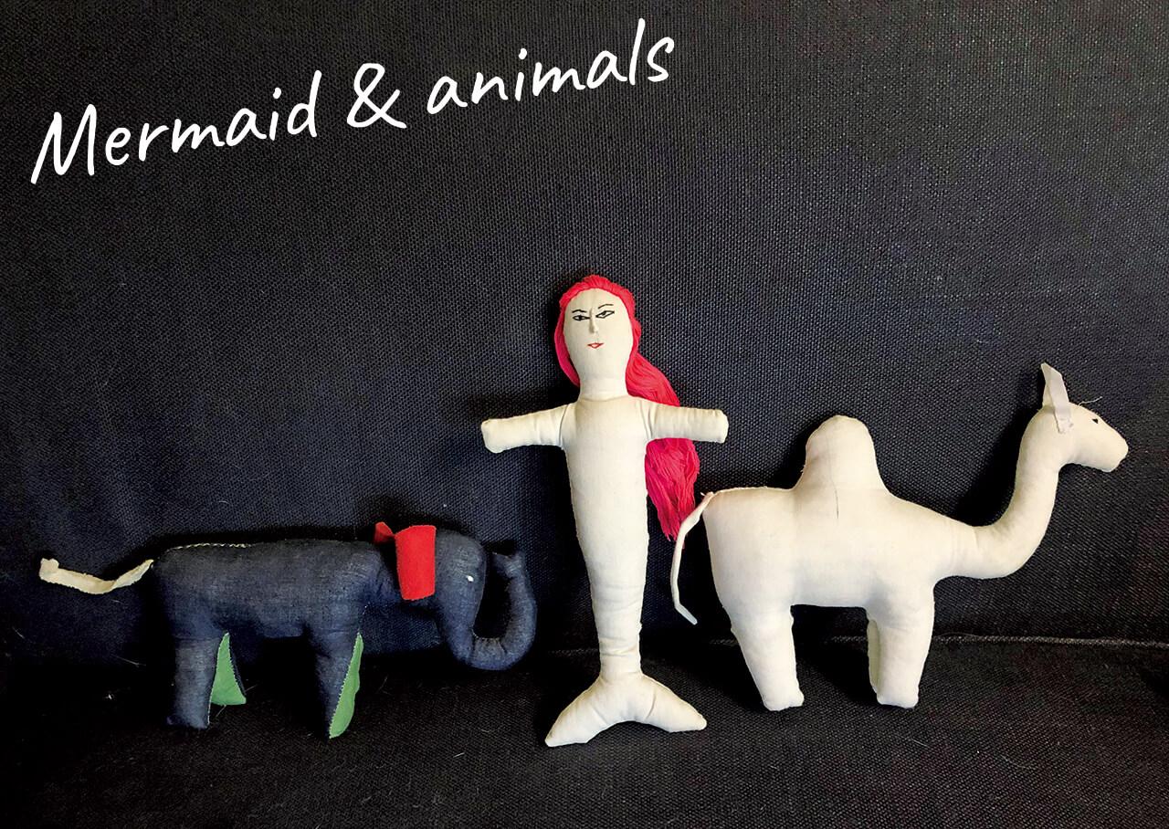 ラオスで手に入れた魔除け人形は ユーモラスなフォルムと表情がツボ